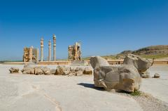 Columns of ancient city of persepolis Stock Photos