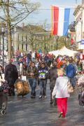 Typical dutch flea market on queen's day Stock Photos