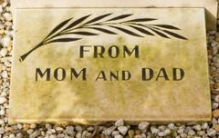 an epitaph on an old grave - stock photo