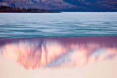 Mt laurier mirrored on lake laberge, yukon, canada Stock Photos