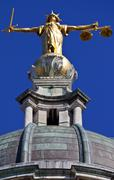 Lady Justice statue ontop of the Old Bailey in London Stock Photos