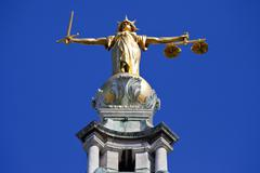 Lady Justice statue ontop of the Old Bailey in London - stock photo