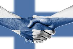 Stock Photo of man and woman shaking hands, finland flag