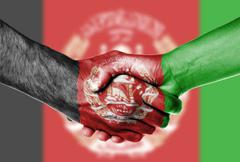 Man and woman shaking hands, Afghanistan flag Stock Photos