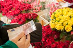 a woman buying flowers - stock photo