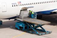 Stock Photo of amsterdam - may 11: boeing 767-332er of delta is being loaded by ground perso