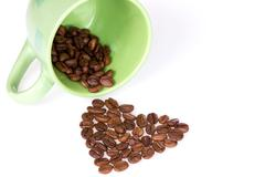 Stock Photo of cup and coffee beans heart