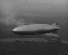 Hindenburg flying over New York Stock Footage