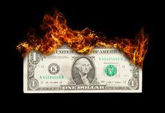 Burning dollar bill symbolizing careless money management Stock Illustration