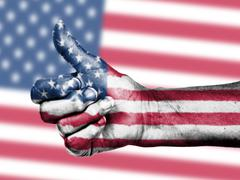 Us flag on thumbs up hand Stock Photos