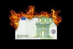 Burning money Stock Photos