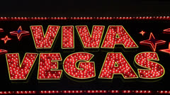 Flashing Neon 'Viva Vegas' Sign Stock Footage