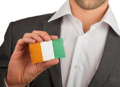 businessman is holding a business card, cote d'ivore - stock photo