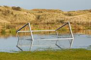 Stock Photo of football goal in a flooded field