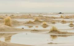 Low tide at the dunes of ameland Stock Photos