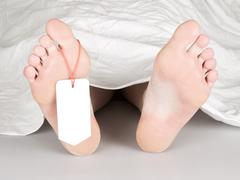 Dead body with toe tag Stock Photos