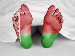 Dead body under a white sheet, Belarus flag Stock Photos
