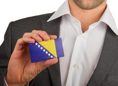 Stock Photo of businessman is holding a business card, bosnia and herzegovina