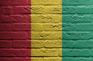 Stock Illustration of brick wall with a painting of a flag, guinea