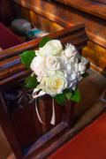Wedding bouquet on pews Stock Photos
