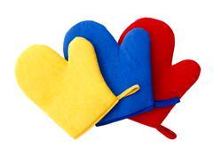 multi colour oven glove mitt white background - stock photo