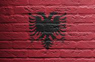 Stock Illustration of brick wall with a painting of a flag, albania