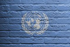 brick wall with a painting of a flag, un - stock illustration