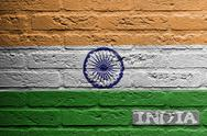 Stock Illustration of brick wall with a painting of a flag, india