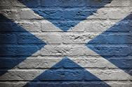 Stock Illustration of brick wall with a painting of a flag, scotland