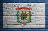 Stock Illustration of brick wall with a painting of a flag, west virginia