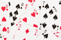Large collection of used playing cards Stock Photos