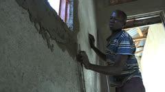 Man Works Plastering Stock Footage