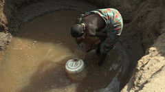 Collecting Water from Water Hole - stock footage