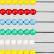 close-up of an abacus on a white background - stock photo