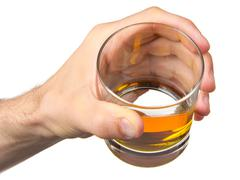 Stock Photo of glass of whisky in hand
