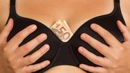 Stock Photo of concept - woman with cash in a bra