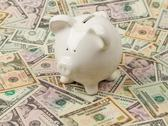 Stock Photo of piggy bank on dollar bills