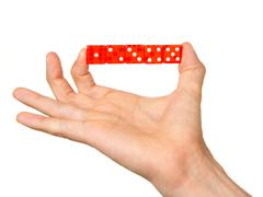 Man holding five red dice Stock Photos
