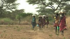 Women Walk Home from Market Stock Footage