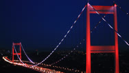 Bridge with red lights at dark blue sky Stock Footage
