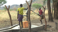 Girls at the Water Pump Stock Footage