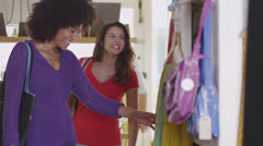 Two happy, attractive young women shopping together Stock Footage