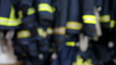 Stock Video Footage of Focus on fireman clothes hanging