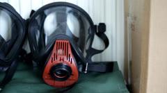 Sliding over fireman gas mask - stock footage