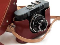 Vintage 35mm film camera with case Stock Photos