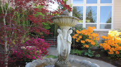 Colorful Frontyard Garden with Water Fountain in Spring 1080p Stock Footage