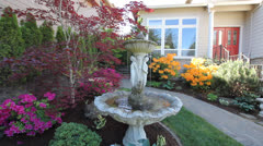 Water Fountain in Flowering Frontyard Spring Season Stock Footage