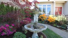 Stock Video Footage of Water Fountain in Flowering Frontyard Spring Season