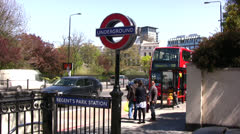 London Underground with red London bus in background Stock Footage