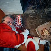 drunk and passed out santa claus - stock photo